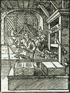 An early illustration of printers creating pamphlets from a press.